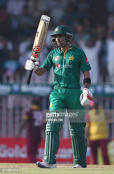 Babar Azam of Pakistan celebrates after reaching his half century during the second One Day International match between Pakistan and West Indies at...