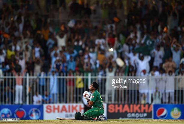Babar Azam of Pakistan celebrates scoring 100 during the first One Day International match between Pakistan and West Indies at Sharjah Cricket...