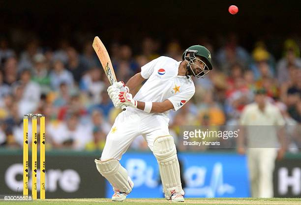 Babar Azam of Pakistan ducks a bouncer during day two of the First Test match between Australia and Pakistan at The Gabba on December 16 2016 in...