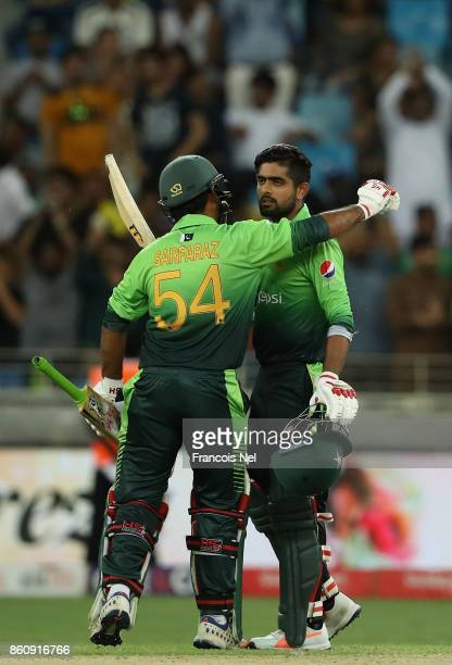 Babar Azam of Pakistan in congratulated by Sarfraz Ahmed of Pakistan after reaching his century during the first One Day International match between...