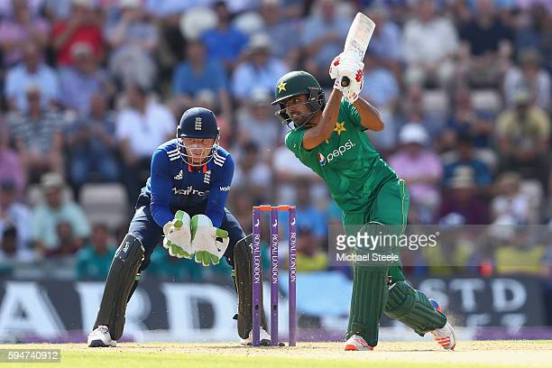 Babar Azam of Pakistan plays through the offside as wicketkeeper Jos Buttler looks on during the first Royal London One Day match between England and...