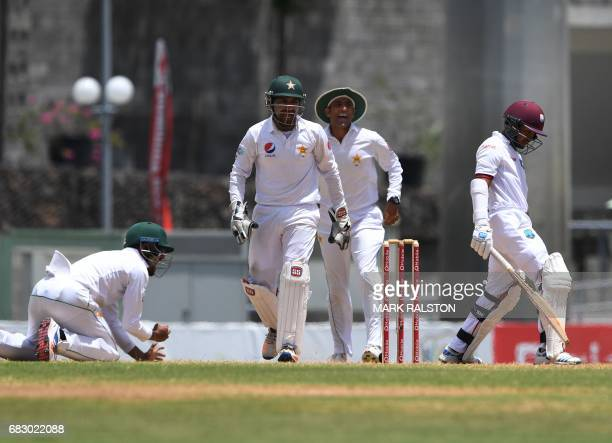 Babar Azam of Pakistan takes the catch to dismiss West Indies batsman Vishaul Singh off the bowling of Yasir Shah for 2 on the fifth day of play of...