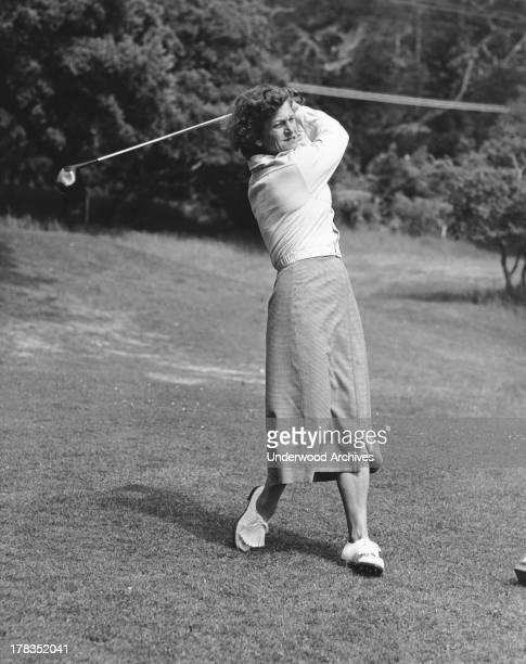 Babe Didrikson at the end of a golf club swing Pebble Beach California c 1949