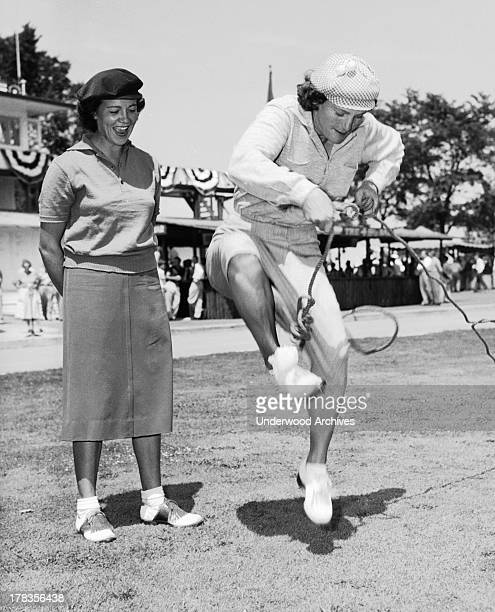 Babe Didrikson attacking a piece of rope c 1950