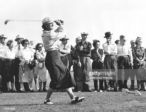 Babe Didrikson driving off the tee in a golf tournament c 1948
