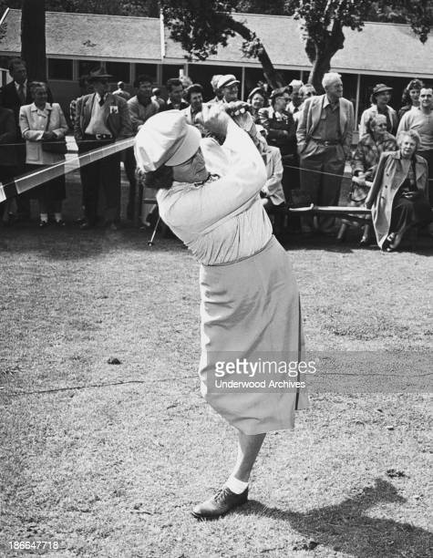 Babe Didrikson gives a golf driving demonstration apparently with only one leg Pebble Beach California early 1950s