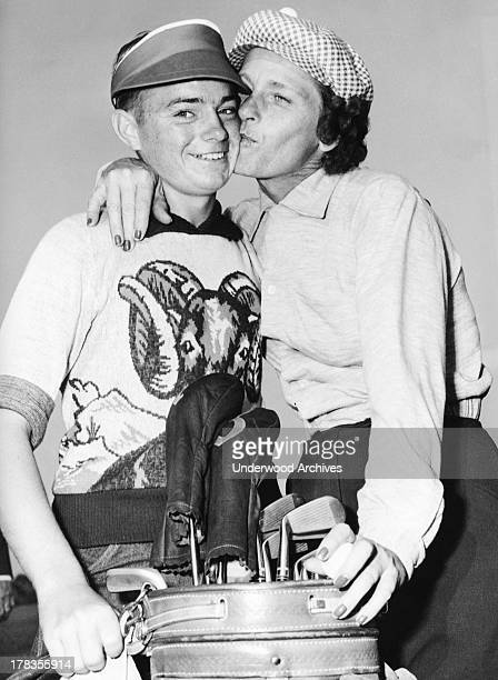 Babe Didrikson gives her caddy a big kiss after she shot a course record at the U S Open at the Rolling Hills Country Club Wichita Kansas 1950