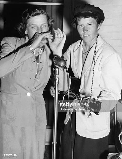 Babe Didrikson plays harmonica accompanying her good friend Betty Dodd who is playing guitar Fresno California 1948
