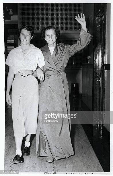 Babe Didrikson Zaharias famed woman athlete waves as she walks down a hall at Hotel Dieu where she is recuperating from a recent major operation With...