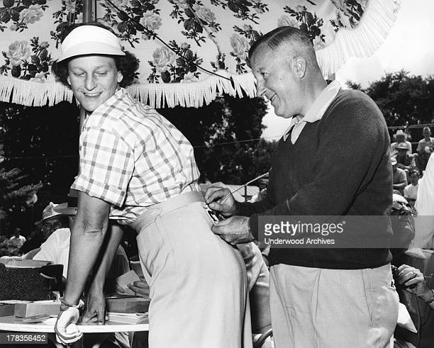 Babe Didrikson Zaharias gets her number pinned on at the LPGA All American Open golf tournament at the Tam O'Shanter Country Club Niles Illinois 1953