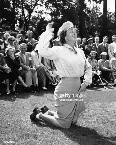 Babe Didrikson Zaharias pays homage to the golf gods at the Weathervane tournament Pebble Beach California 1950
