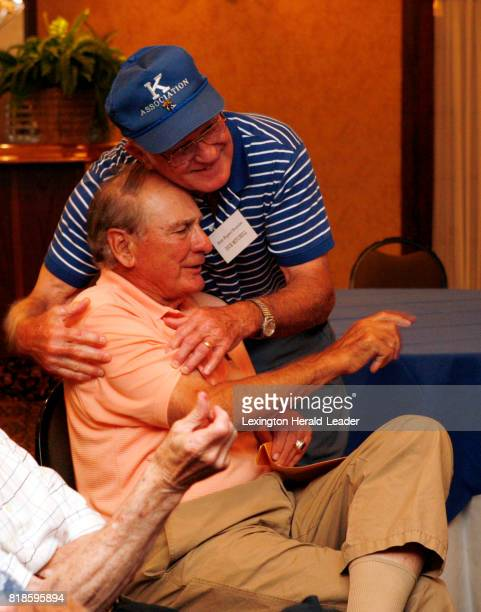 Babe Parilli gets a bear hug from Dick Mitchell during a Paul 'Bear' Bryant reunion at the Crown Plaza Campbell House in Lexington Kentucky on June...