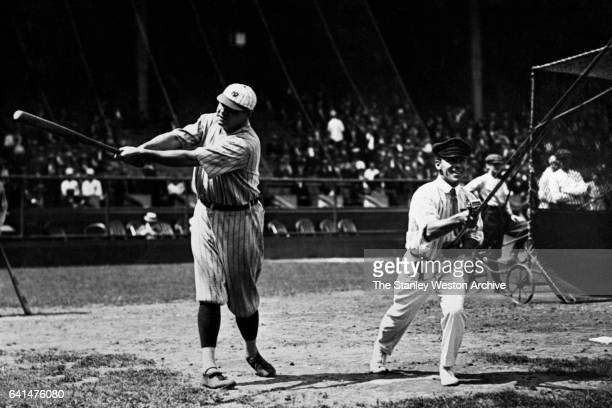 Babe Ruth and surfcasting champion Harold A Lentz who engaged in a contest at the Polo Grounds It was Ruth's prowess hitting a baseball pitted...