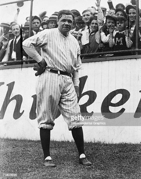 Babe Ruth greets fans in the outfield before a game in Yankee Stadium in New York in 1925