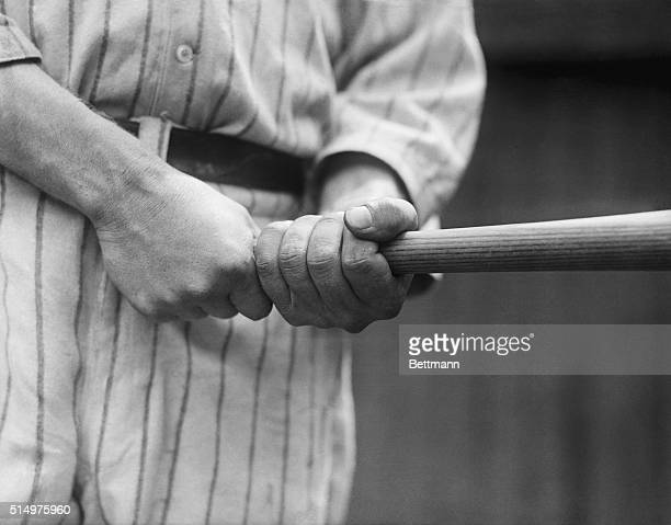 Babe Ruth holding his baseball bat for action