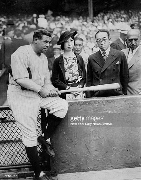 Babe Ruth holds autographed bat for Princess and Prince Kaya of Japan at Yankee Stadium where the Yankees went on to defeat the Detroit Tigers...