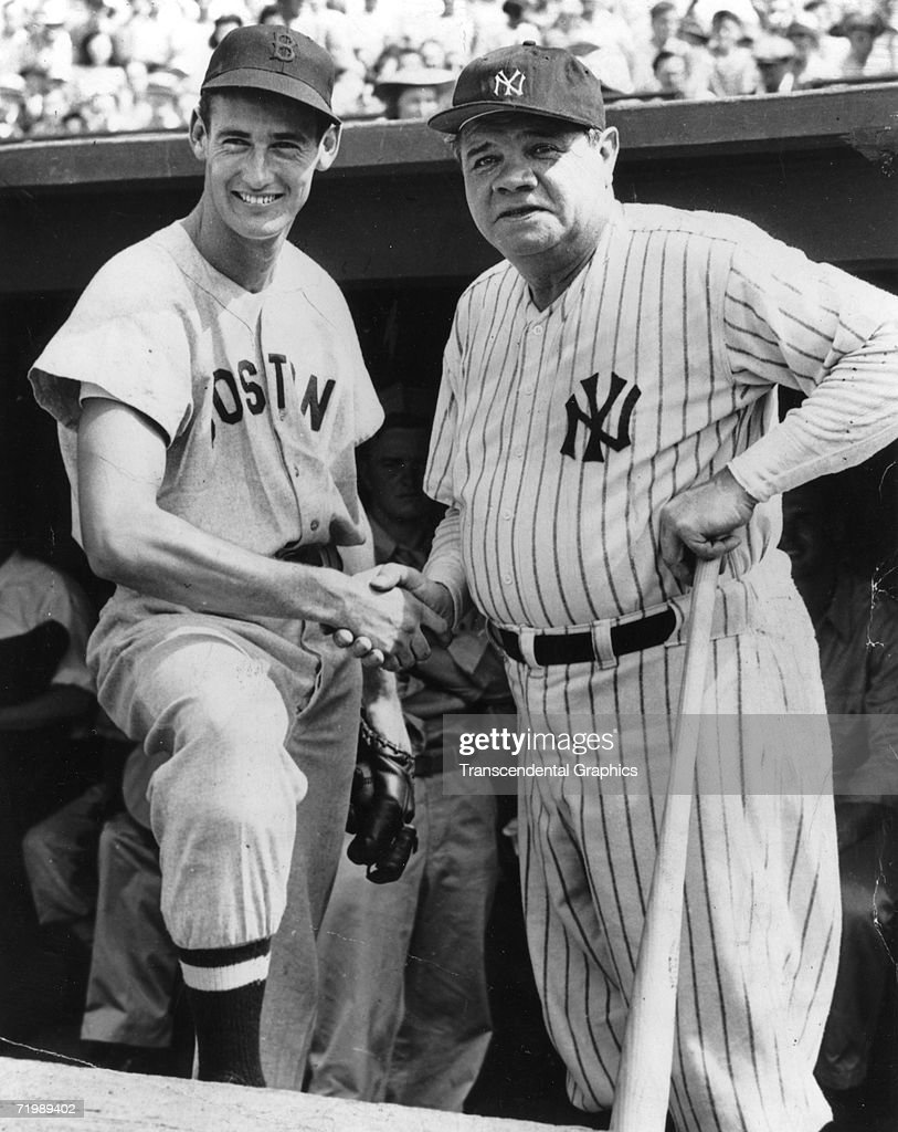 Babe Ruth New York Yankees fan favorite shakes hands with rookie Boston Red Sox outfielder Ted Williams before a game in Yankee Stadium in 1939