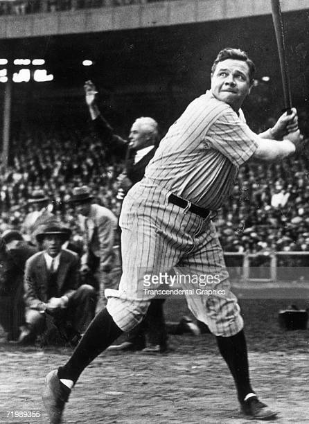 Babe Ruth New York Yankees outfielder concentrates hard on an incoming pitche during batting practice before a game in Yankee Stadium during the 1927...