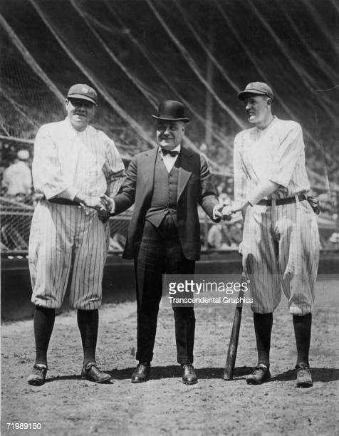 Babe Ruth New York Yankees outfielder left poses in Yankee Stadium in 1922 with Yankee owner Jacob Ruppert center and fellow outfielder Bob Meusel