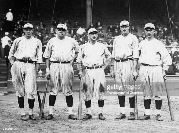 Babe Ruth New York Yankees outfielder second from right poses in Yankee Stadium in 1921 with teammates a group known as 'Murderers Row' composed of...