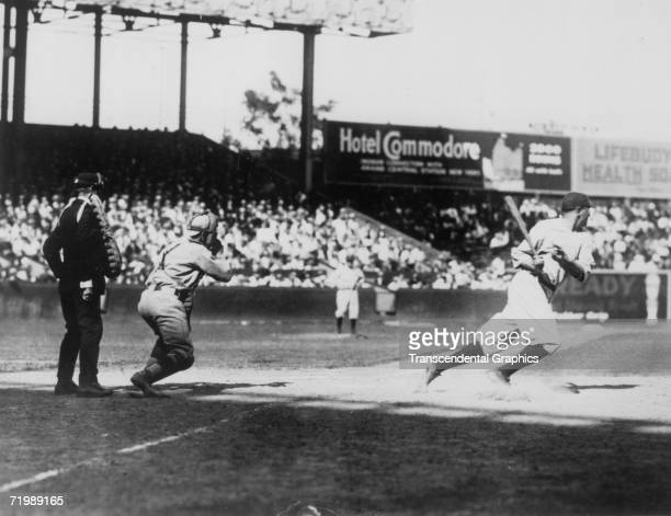 Babe Ruth New York Yankees outfielder smashes a ball toward the outfield during a game with the Red Sox in Yankee Stadium in New York in 1920