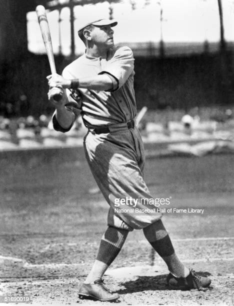 Babe Ruth of the Boston Red Sox watches the flight of the ball as he follows through on a swing during a game Babe Ruth played for the Boston Red Sox...
