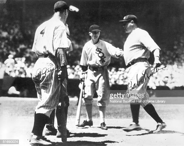 Babe Ruth of the New York Yankees crosses home plate as teammate Lou Gehrig waits to congratulate him during the first inaugural AllStar game at...