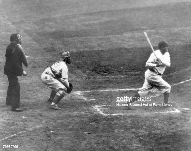 Babe Ruth of the New York Yankees hits his 60th home run of the season against Washington Senators' pitcher Tom Zachary and sets a record that will...