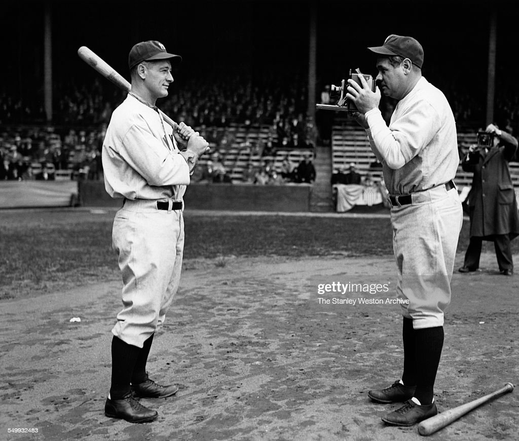 Babe Ruth of the New York Yankees takes a picture of teammate Lou Gehrig circa 1932.