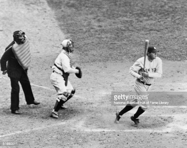 Babe Ruth of the New York Yankees watches the flight of the ball as he follows through on a swing during a game Babe Ruth played for the New York...