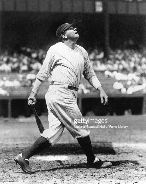 Babe Ruth of the New York Yankees watches the flight of the ball as he follows through on his swing during a game circa 19201934