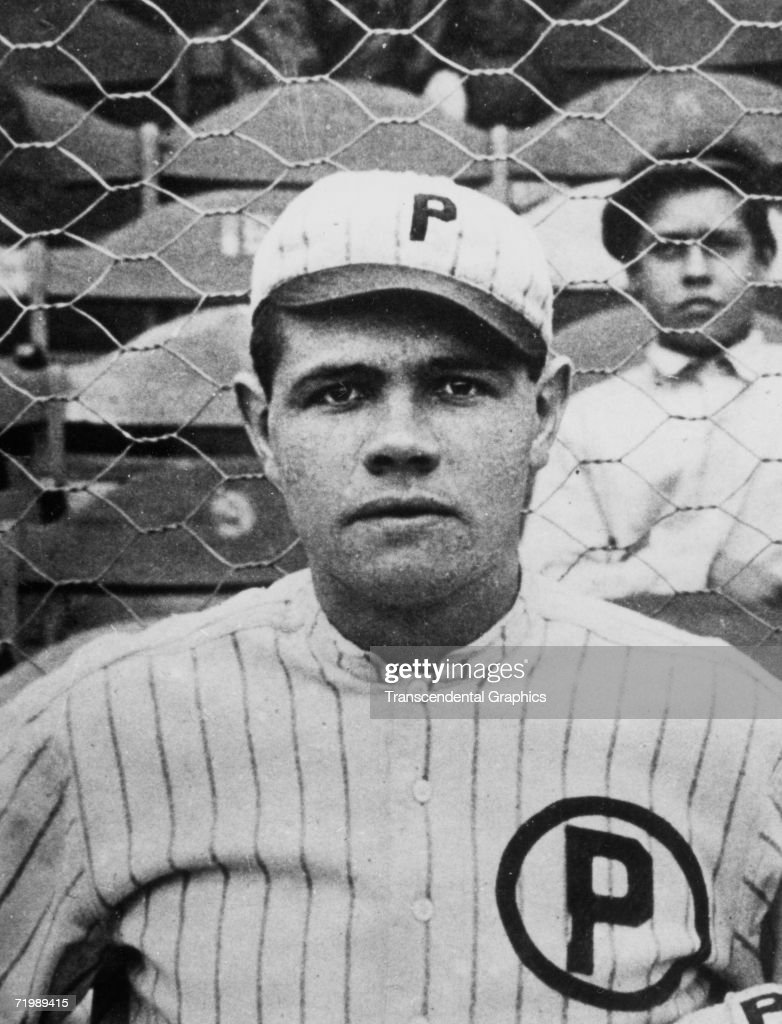 <a gi-track='captionPersonalityLinkClicked' href=/galleries/search?phrase=Babe+Ruth&family=editorial&specificpeople=94423 ng-click='$event.stopPropagation()'>Babe Ruth</a>, pitcher for the Providence Grays minor league team, poses for a team photograph in 1914.