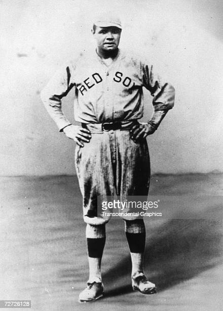 Babe Ruth poses for a portrait in his Boston Red Sox uniform in 1918
