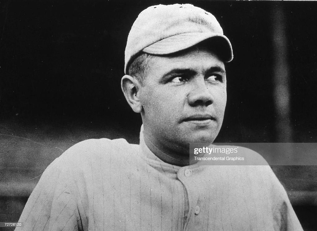 Babe Ruth poses for a portrait in his home Boston Red Sox uniform in 1916