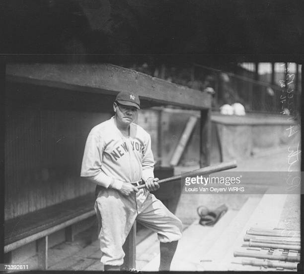 Babe Ruth standing before game in visitor's dugout The Yankees split a doubleheaderwith the Indians at League Park losing the first 60 and taking the...
