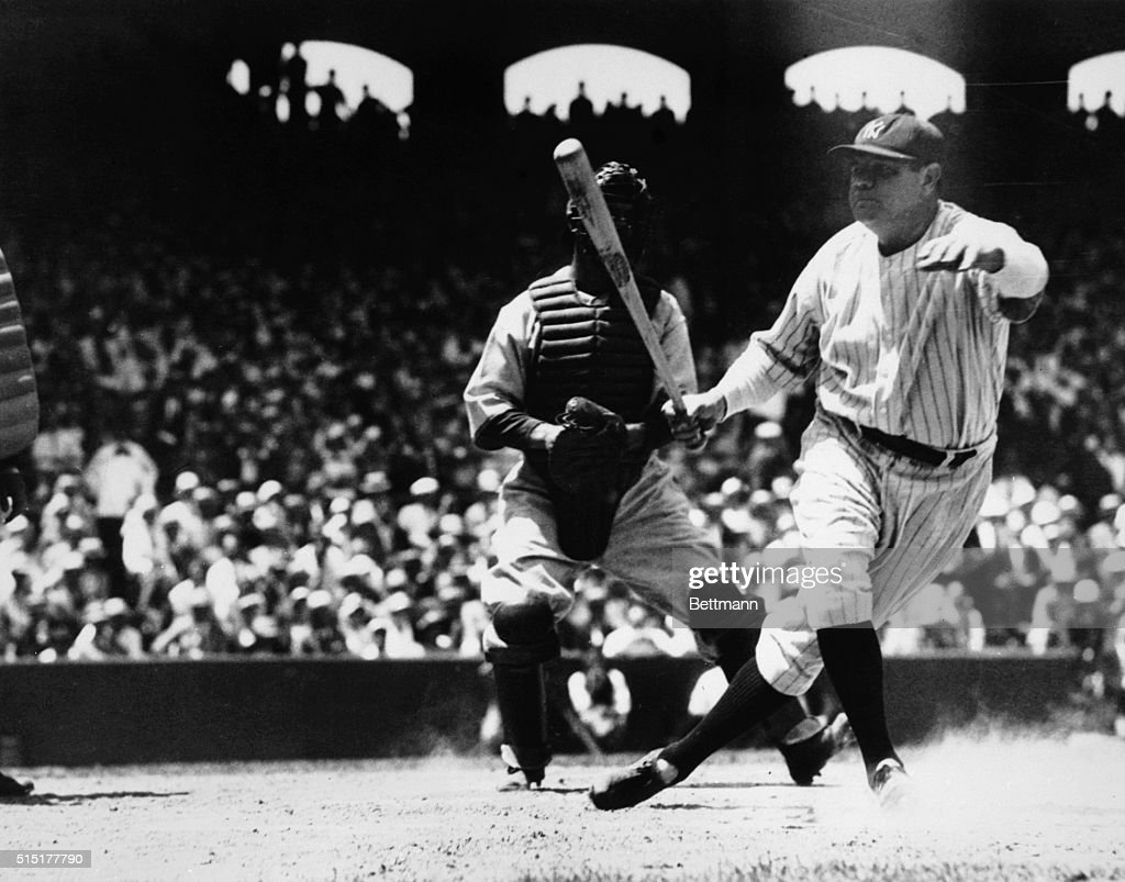 Babe Ruth starts running after hitting a home run at Chicago's Comiskey Park