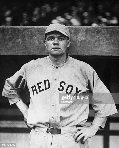 Babe Ruth wearing the uniform of the Boston Red Sox the team he played with from 1915 until he joined the Yankees in 1920 Half length photograph