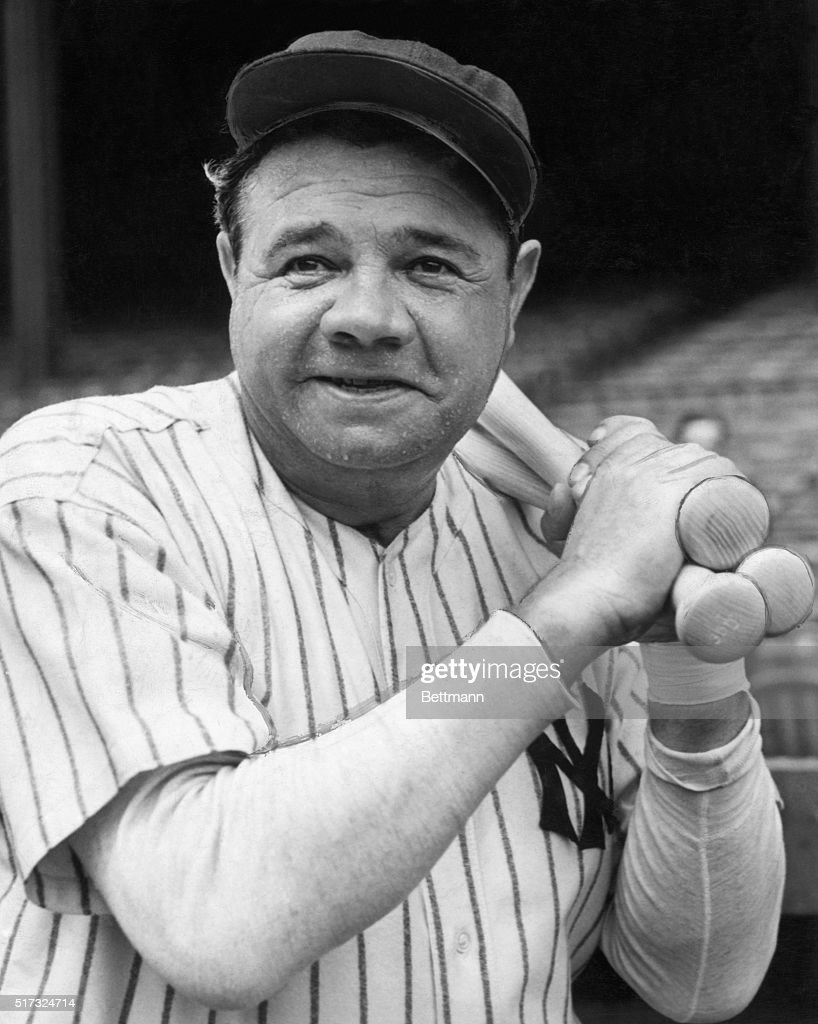 Babe Ruth with usual warmup bats slung over left shoulder begins workout for Army Navy benefit in Yankee Stadium