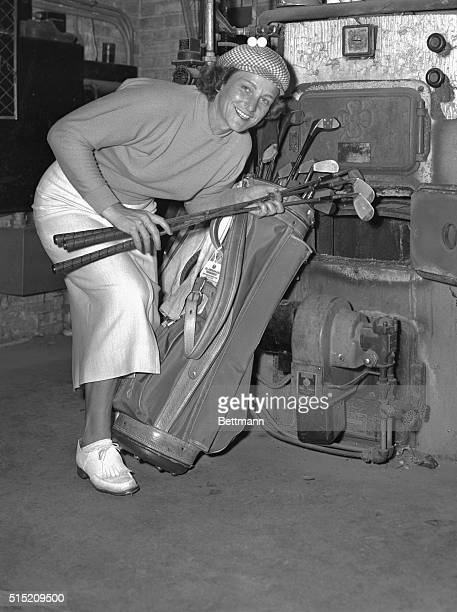 Babe Zaharias takes time out from the World Championship of Golf at Chicago's Tam O'Shanter to heat up some of her irons at a furnace She said that...