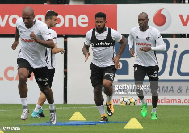 Babel Jeremain Lens 2nd R and Atiba Hutchinson of Besiktas attend a training session ahead of the Turkish Spor Toto Super Lig new season match...