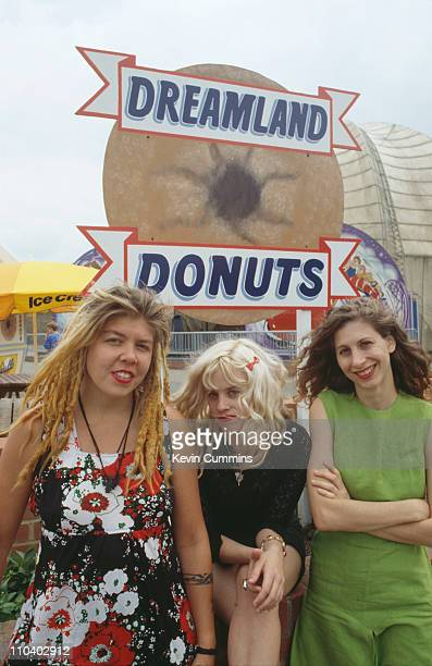 Babes In Toyland at the Dreamland amusement park Margate Kent July 1992 Left to right drummer Lori Barbero singer/guitarist Kat Bjelland and bassist...