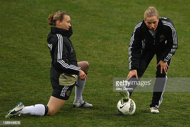Babett Peter and Tabea Kemme warm up during a training session of the German women's national football team at Buca Arena on February 14 2012 in...
