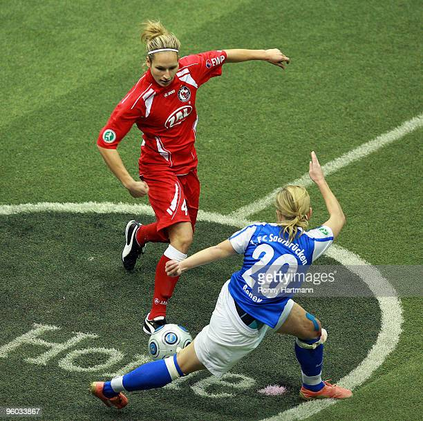 Babett Peter of 1 FFC Turbine Potsdam battles for the ball with Noemie Beney of 1 FC Saarbruecken during the semifinal match of the THome DFB Indoor...