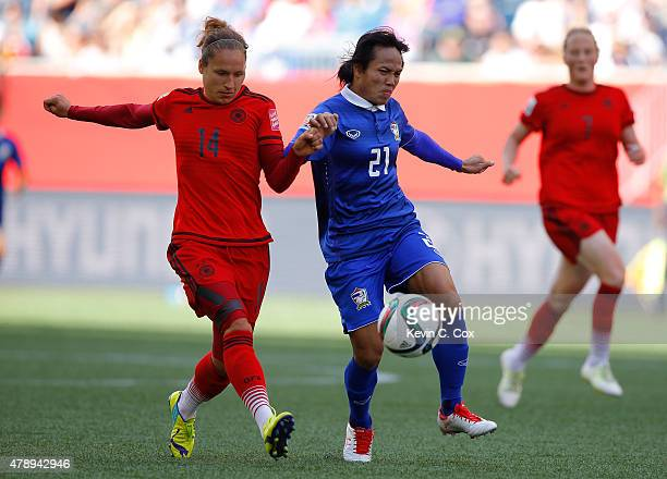 Babett Peter of Germany against Kanjana SungNgoen of Thailand during the FIFA Women's World Cup Canada 2015 match between Thailand and Germany at...