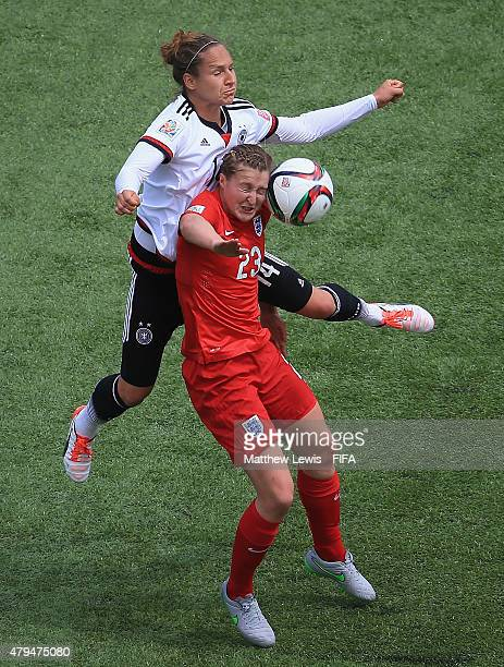 Babett Peter of Germany and Ellen White of England challenge for the ball during the FIFA Women's World Cup 2015 Third Place Playoff match between...