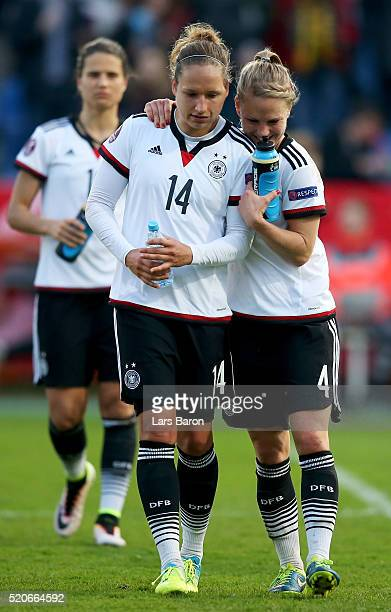 Babett Peter of Germany and Leonie Maier of Germany celebrate after winning the UEFA Women's Euro 2017 qualifier between Germany and Croatia at...