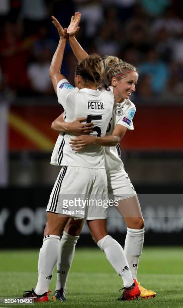 Babett Peter of Germany celebrate with her team mates after she scores the 2nd goal by penalty kick during the Group B match between Germany and...