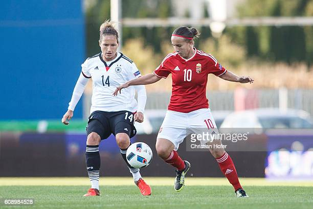 Babett Peter of Germany competes for the ball with Fanni Vago of Hungary during the UEFA Women's Euro 2017 Qualifier between Hungary and Germany at...
