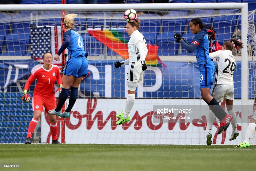 Babett Peter #5 of Germany heads clear while challenged by Amadine Henry #6 of France and Wendie Renard #3 of France during the France Vs Germany SheBelieves Cup International match at Red Bull Arena on March 4, 2017 in Harrison, New Jersey.
