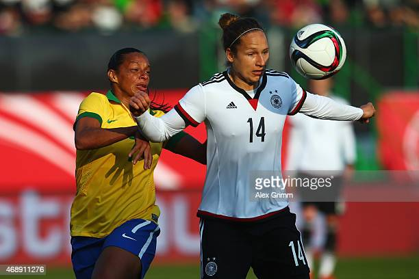 Babett Peter of Germany is challenged by Rosana of Brazil during the Women's International Friendly match between Germany and Brazil at TrolliArena...